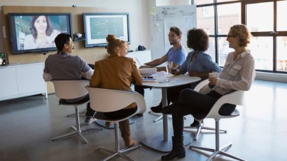 People meeting in a conference room around a table