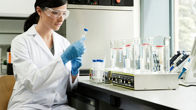 Female scientist working with chemicals in lab