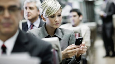 Businesswoman using mobile device while traveling