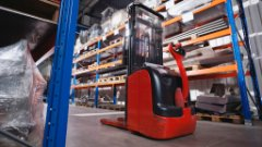 A forklift drives through a warehouse