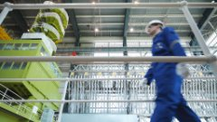 Power plant worker walking across a platform