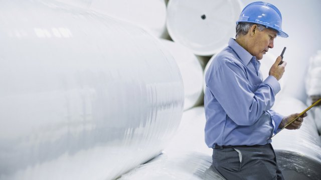 Man with hard hat in a papermill