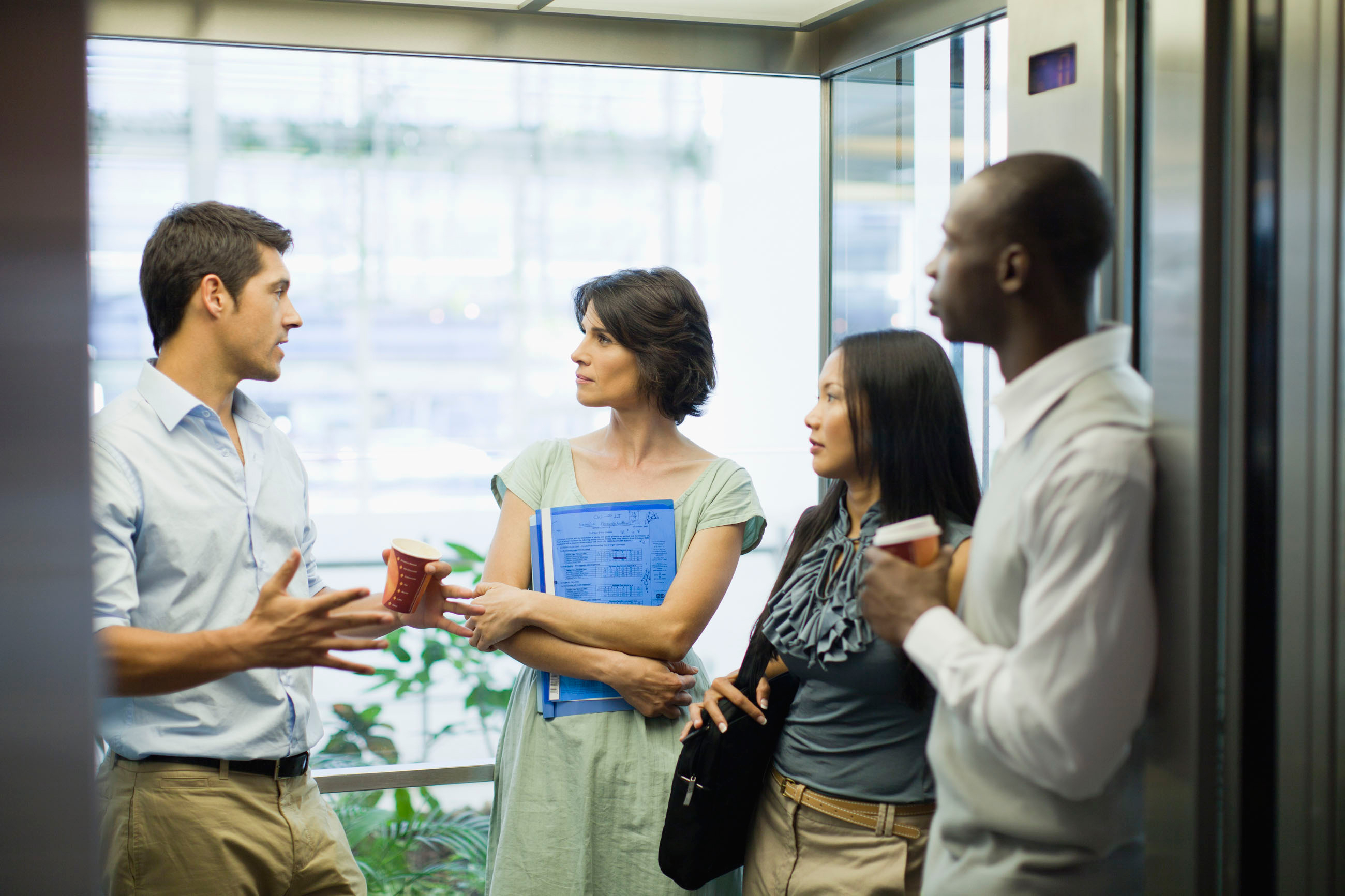 Small group of people talking in office setting