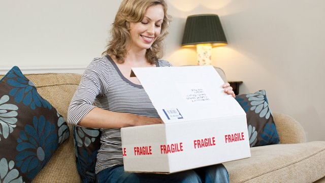 Woman opening a parcel