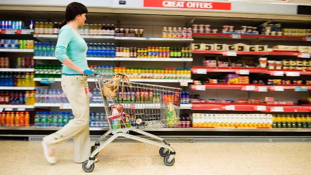 Shopper pushing a cart in a supermarket
