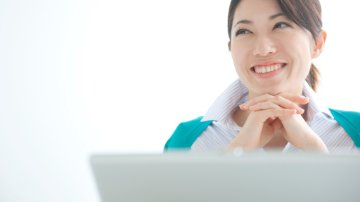 Businesswoman using SAP software on a laptop