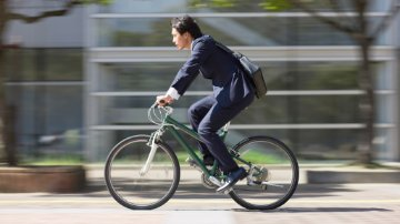 Businessman riding a bike to work
