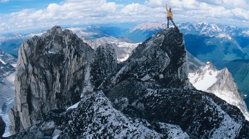 Man standing on mountain summit