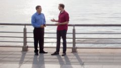 Analysts discussing cloud BI software on a seawall