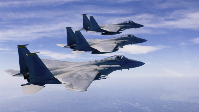 Three military jets flying in formation