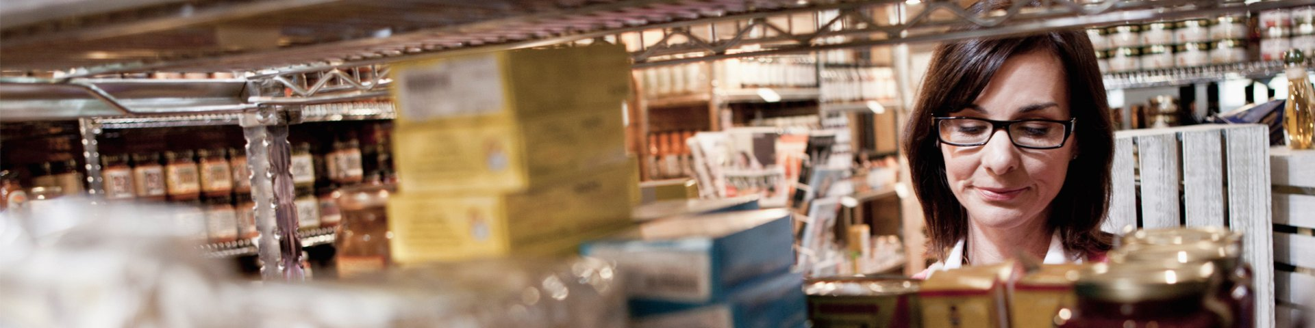 Woman checking goods in warehouse before shipping to wholesale client