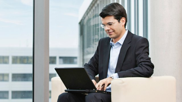 Businessman using laptop developed by a high tech OEM