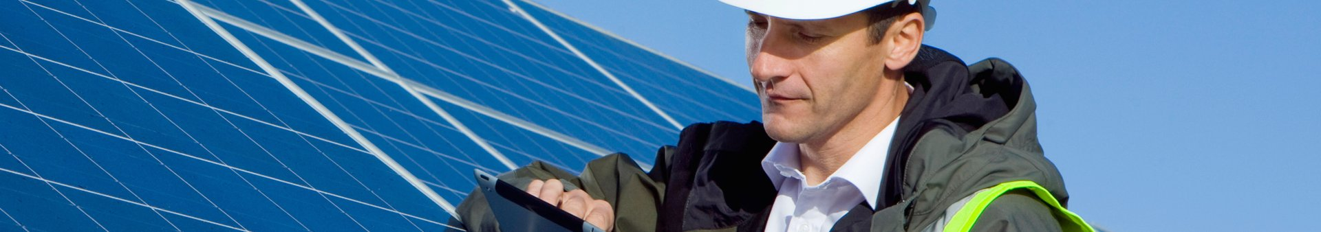 Utilities worker adjusting solar panels for energy supply optimisation