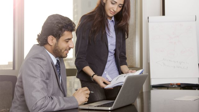 Employees using SAP Disclosure Management in the office