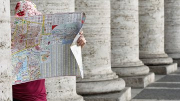 Vacationing woman looking at a map