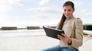 Woman connecting to cloud applications on her tablet