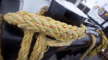 Rope tied around a ship's timberhead