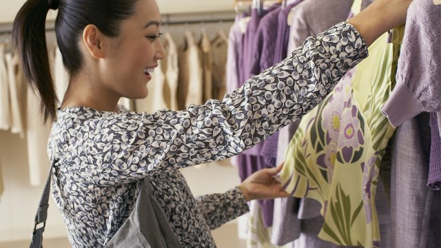 Woman looking at clothes in a retail store