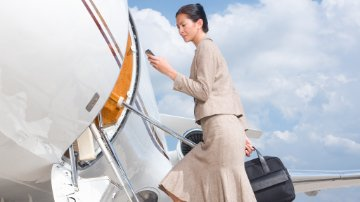 Businesswoman boarding an airplane at an airport