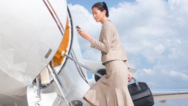 Businesswoman boarding a plane