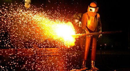 Image of a worker in a steel mill