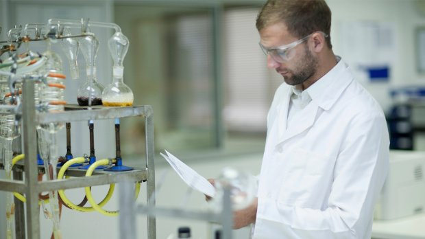 Laboratory scene with a worker in a white coat