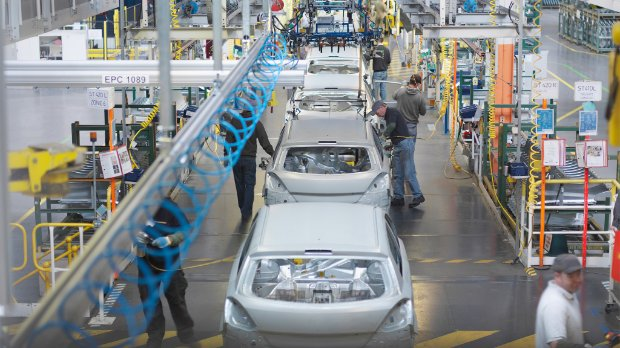 Image of cars in assembly line