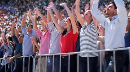 Fans cheering at sporting event