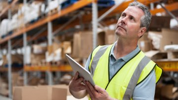 worker looking at warehouse inventory