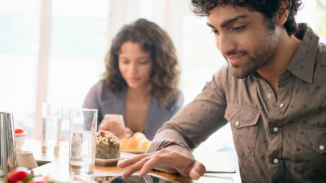 Couple ordering food on tablet together