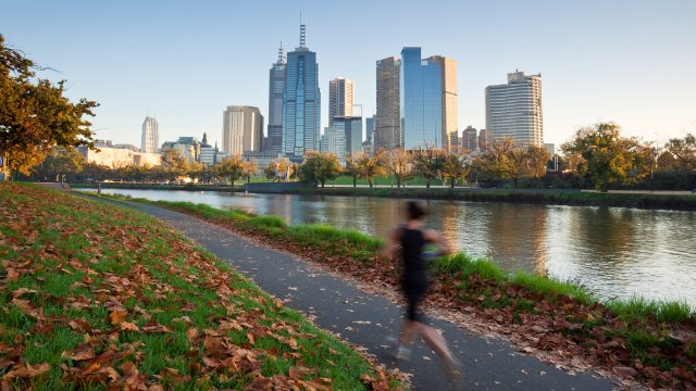Woman running with skyline in the background
