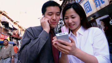 Couple looking at a mobile device