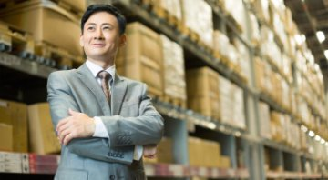 Businessman who has used demand sensing to optimize inventory