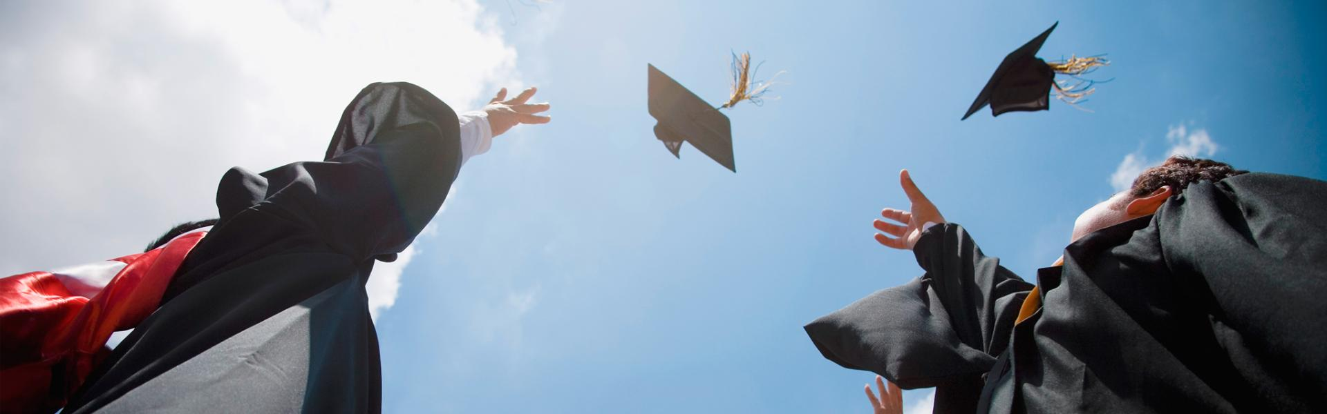 Graduates from a SAP University Alliances partner tossing their caps