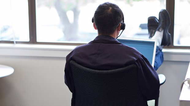 Image of a professional listening to recorded Webinars
