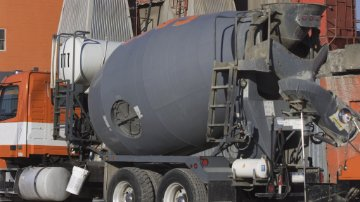 Truck being loaded with ready-mix concrete at the plant