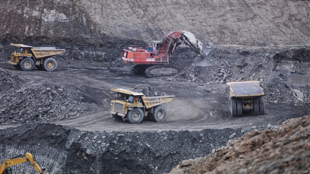 Trucks and diggers in a coal mine