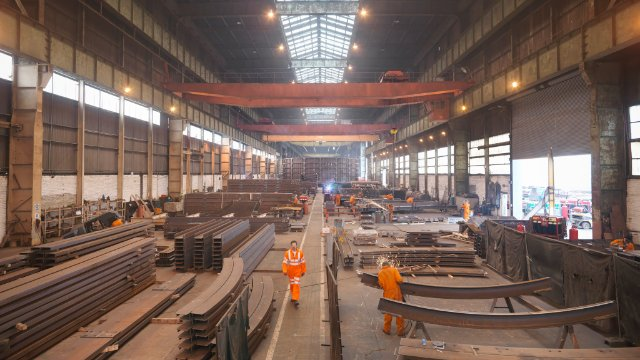 Overview of workers in marine fabrication factory