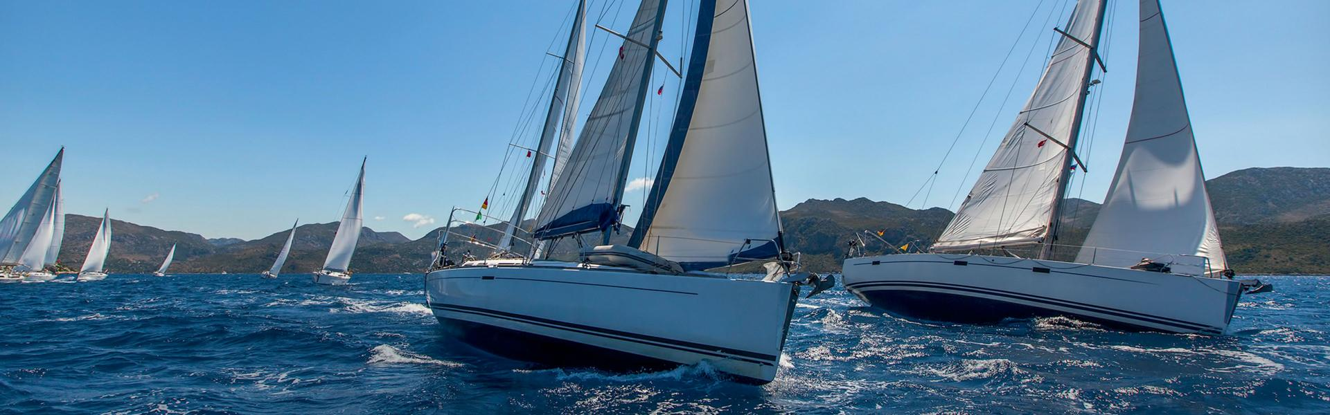 Sailing yacht race. Sailing ships yachts with white sails in the open sea