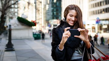 Marketer socializing with customer on her mobile device