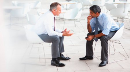 Human resources manager talking to an employee