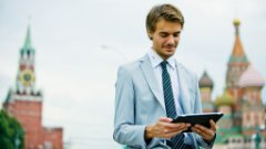 Business professional using EPM software on ipad