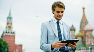 Business professional on an ipad using BI software