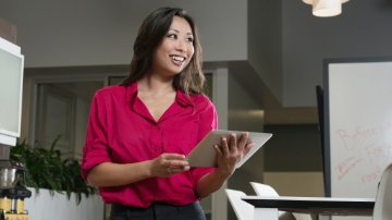 Businesswoman using real-time ERP on a tablet