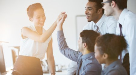 Businesspeople cheering in an office