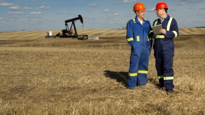 Two men talking in a oil field