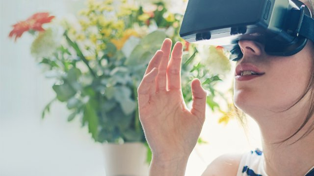 Woman looking through view finder