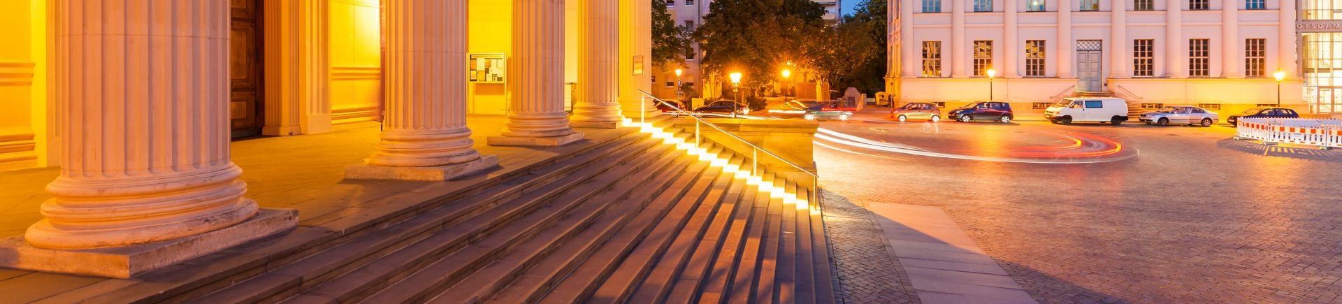 Photo of steps and columns of a public sector building at night