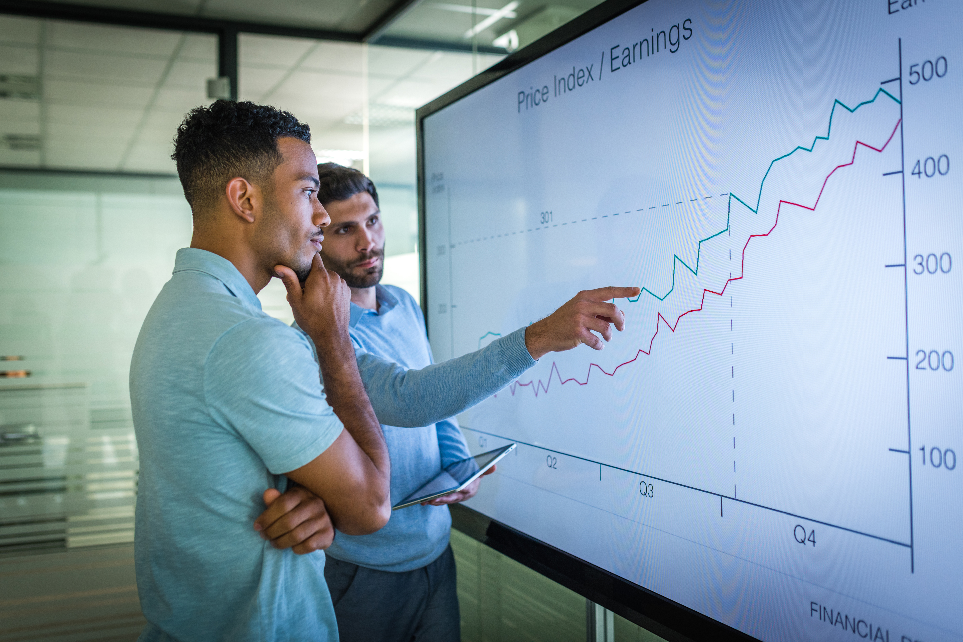 two men analyzing graph