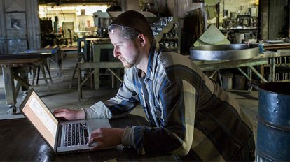 Man using software at manufacturing plant